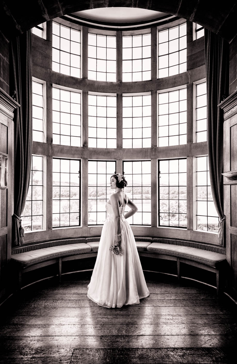 Classic wedding photo of the bride in front of a window by Chris Wright, Lancashire wedding photographer